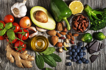 Selection of healthy food on wooden background. Healthy diet foods for heart cholesterol and diabetes.