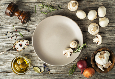 prepared dish: Mushrooms champignons with fresh ingredients on wooden background