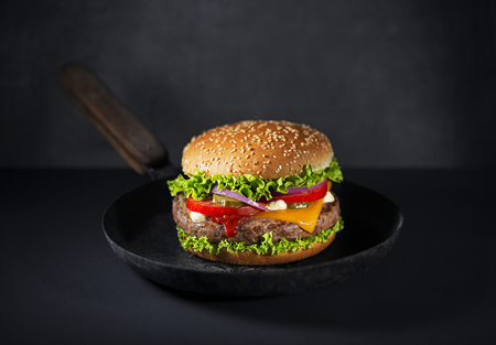 Making Homemade hamburger or burger with fresh vegetables and cheese
