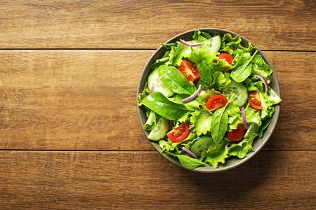 Fresh green lettuce salad with tomato and spinach