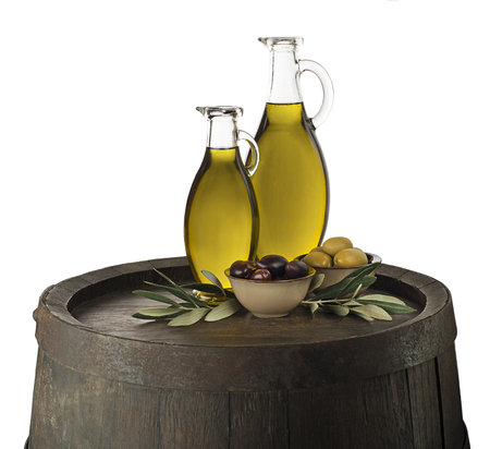 Bottles of Extra virgin healthy Olive oil with barrel background