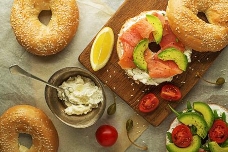 Bagel sandwich with avocado salmon cream cheese. Healthy food. 스톡 콘텐츠