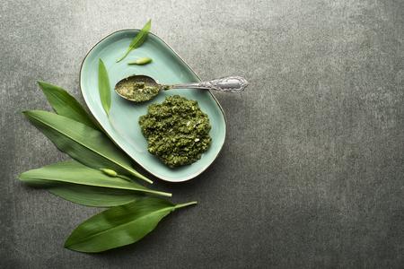 Fresh ramson or wild garlic ingredients for pesto. Healthy spring food concept