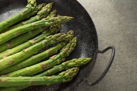 Fresh of green Asparagus. Cooking healthy meal in pan. Bunches of green asparagus