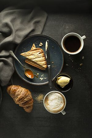 Breakfast served with croissant, coffee, jam and butter. Continental breakfast table