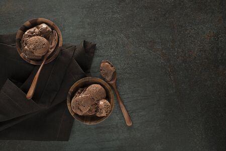 Homemade Organic chocolate Ice Cream scoops in bowls close up Stockfoto
