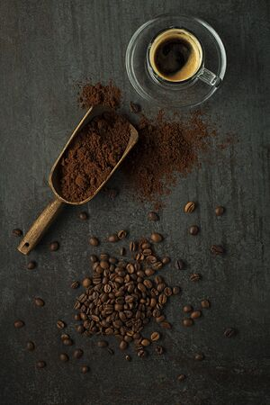 Espresso Coffee cup with beans on dark table. Copyspace for your concept text