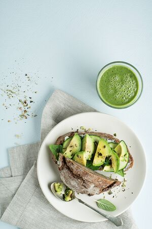 Delicious healthy meal with Avocado sandwich made with fresh sliced avocados. Concept for a tasty and healthy meal.