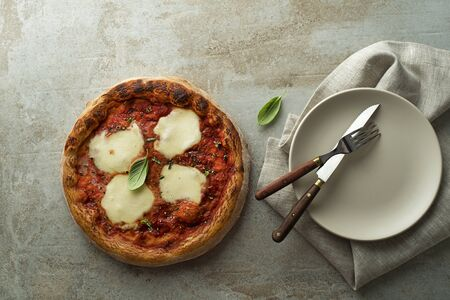 Pizza Margherita served with mozzarella cheese, tomato sauce and fresh basil 스톡 콘텐츠