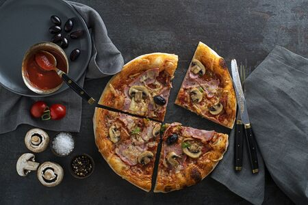 Pizza ingredients served with mozzarella cheese, ham, mushrooms and tomato sauce