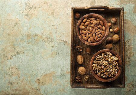 Assortment of mixed nuts. Hazelnuts, walnuts and almonds. Healthy food. Foto de archivo - 132011497