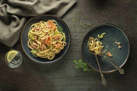 Eating fresh pasta with smoked salmon in cream sauce. Healthy vegetarian meal Zdjęcie Seryjne