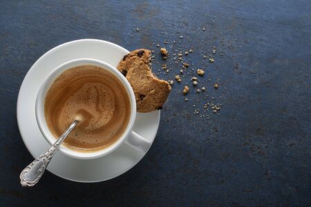Coffee cup with milk and spoon close up. Copyspace for your text