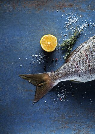 Delicious fresh fish on vintage background. Healthy diet eating or cooking concept Zdjęcie Seryjne