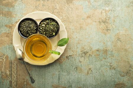 Cup of tea with dry tea collection of different types. Healthy drink concept