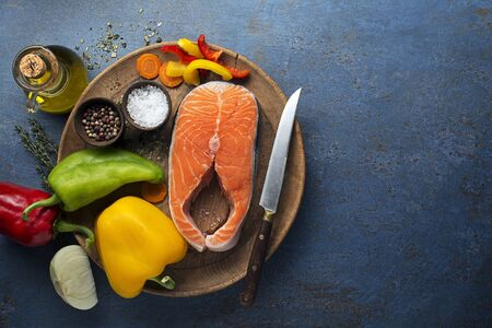 Cooking healthy meal with salmon steak  and vegetables Zdjęcie Seryjne