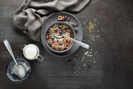 Breakfast served with oatmeal, yogurt and fruits.