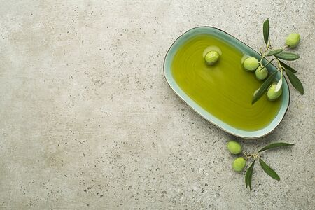 Healthy olive oil with olives  close up.