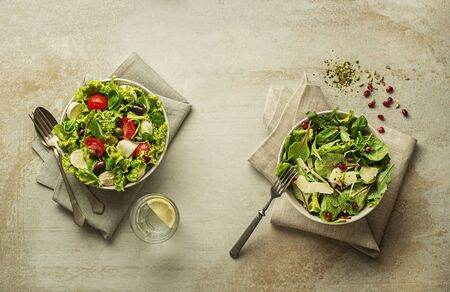 Healthy salads with spinach, cheese, tomato and seeds.