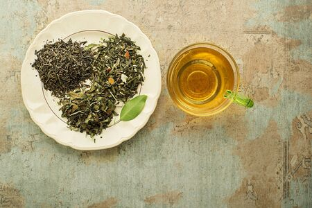 Cup of tea with dry tea- classic black and green tea flavour