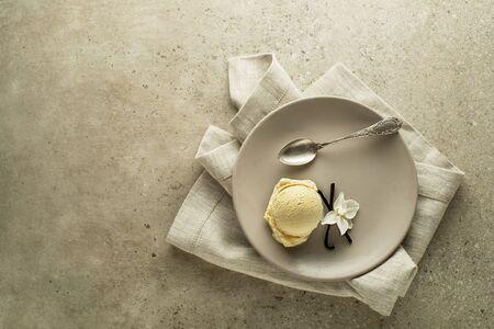 Homemade Organic Vanilla soft Ice Cream. Vanilla frozen yogurt or soft ice cream with flower