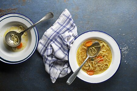 Served hot Hen and Chicken soup with noodles a place for text. Healthy meal. Zdjęcie Seryjne