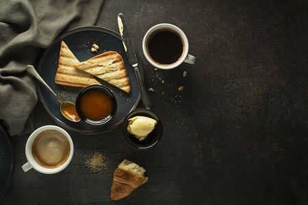 Continental Breakfast meal served with coffee, croissant, toast, jam and butter. Delicious coffee table. Zdjęcie Seryjne