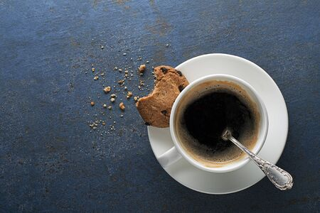 Coffee cup with cookies close up. Copyspace for your text