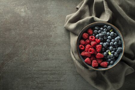 Colorful assorted mix of blueberry and raspberry. Berries overhead closeup
