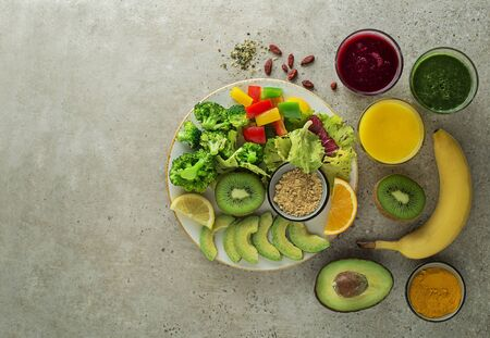Healthy fresh fruit and vegetable smoothies with assorted ingredients served in glasses.