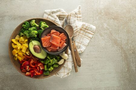 Cooking healthy meal with salmon steak and mixed vegetables. Healthy diet concept Zdjęcie Seryjne