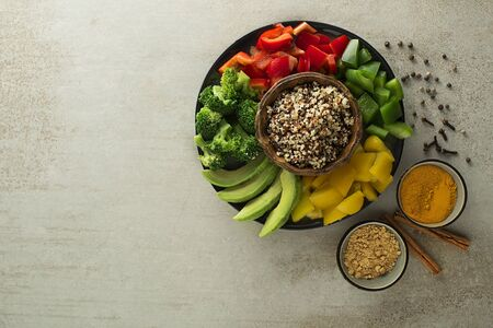 Healthy vegan lunch bowl. Avocado, quinoa, peppers, broccoli and spices. Healthy concept of Vegetables salad. Top view
