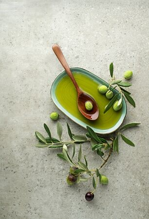Healthy olive oil with olives and leaves background close up. Healthy concept