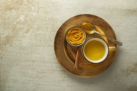 Healthy drink made from turmeric roots, spices, milk and honey. Golden Milk, made with turmeric and other spices