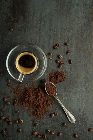 Espresso Coffee cup with beans on dark table. Copyspace for your concept text or coffee table