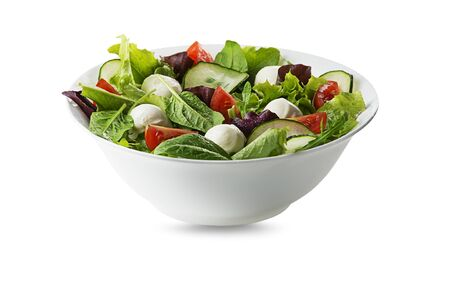 Healthy Green salad with mozzarella cheese and fresh vegetables isolated on white background