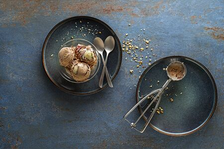 Homemade Organic chocolate Ice Cream scoops with nuts in a bowl