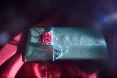 exquisite handmade chocolates. glamorous packing with rose. around the glow of light