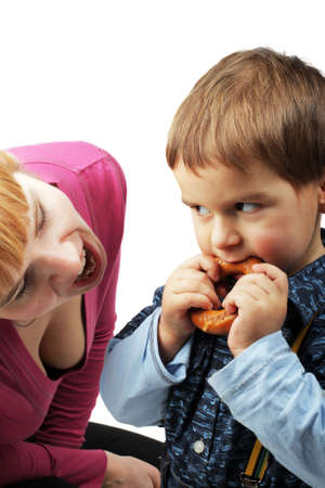 boublik: mom and her son eating one bagel on white background