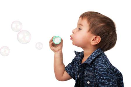 little boy blow bubbles photo