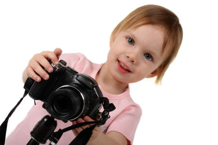 photography session: little beauty girl photograph you by digital camera on tripod