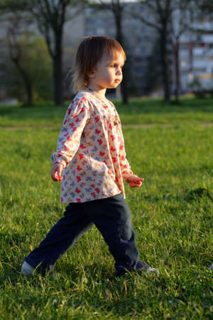 quickly: Little beauty girl going quickly  towards sunset