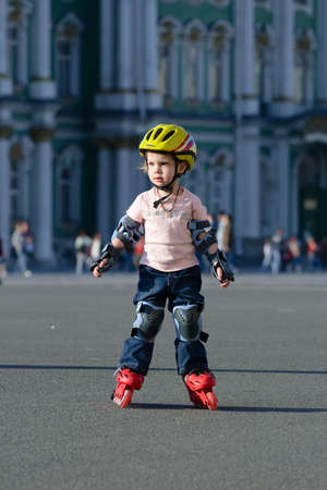 beaty: Girl on roller blades with full defence and  crash helmet at sunny evening.