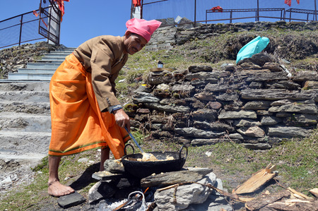 during: A man preparing halwa poori(puri) outdoors during tonsure(mundan) ceremony, Shimla, Himachal Pradesh, India, Asia.