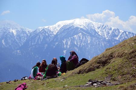 conversing: Ladies chatting and enjoying sunlight on the hillside, Shimla, Himachal Pradesh, India, Asia.