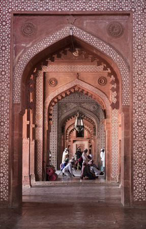 jama masjid: Agra, India ?%u20AC%u201C October 12: Muslims praying inside the red sandstone doorway and hall of the fort Jama Masjid Friday Mosque on October 12, 2016 in Fatehpur Sikri, Agra, India.