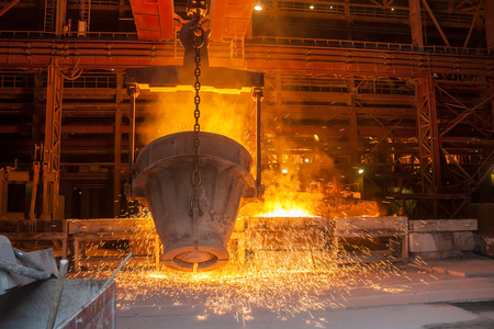 Smelting metal in a metallurgical plant Stock Photo