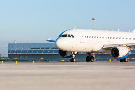 passenger aircraft: Taxiing passenger aircraft on the airport apron