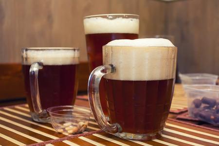 unbottled: Glasses of dark beer in a pub