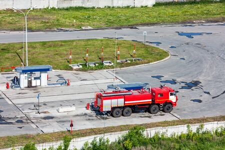 Airfield fire truck at a gas station Stock Photo
